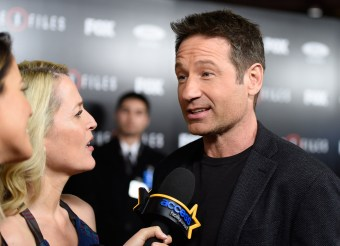 LOS ANGELES, CA - JANUARY 12: Actress Gillian Anderson and actor David Duchovny are interviewed at the premiere of Fox's 'The X-Files' at California Science Center on January 12, 2016 in Los Angeles, California. (Photo by Angela Weiss/Getty Images)